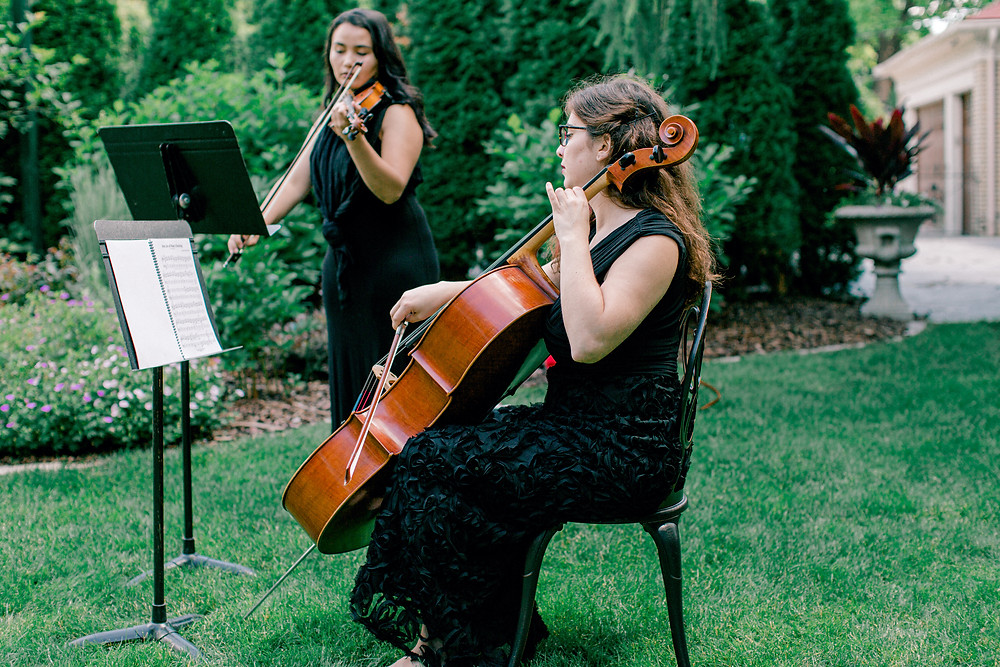 live violin and cello performance at a wedding ceremony