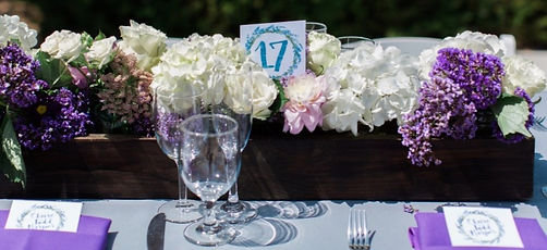 Guest table number surrounded by flowers for wedding reception at Imagine Park in Santa Barbara, California