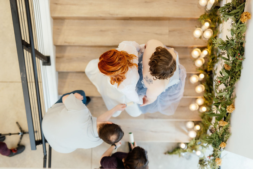 LGBTQ+ friendly wedding vendors dusting brides' gowns at Pinewood Weddings and Events in Cambridge, Minnesota