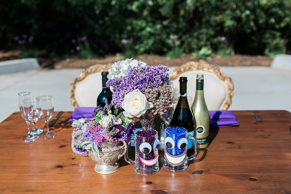 Mugs filled with beads and given smiling faces and googly eyes give insight into this couple's love story.