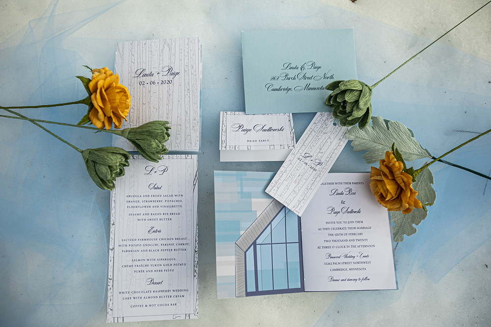Wedding stationery with paper flowers at Pinewood Weddings and Events in Cambridge, MN