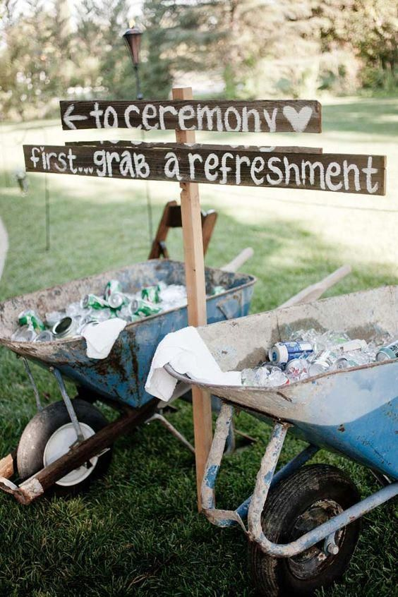 Wheelbarrows filled with ice and beverages