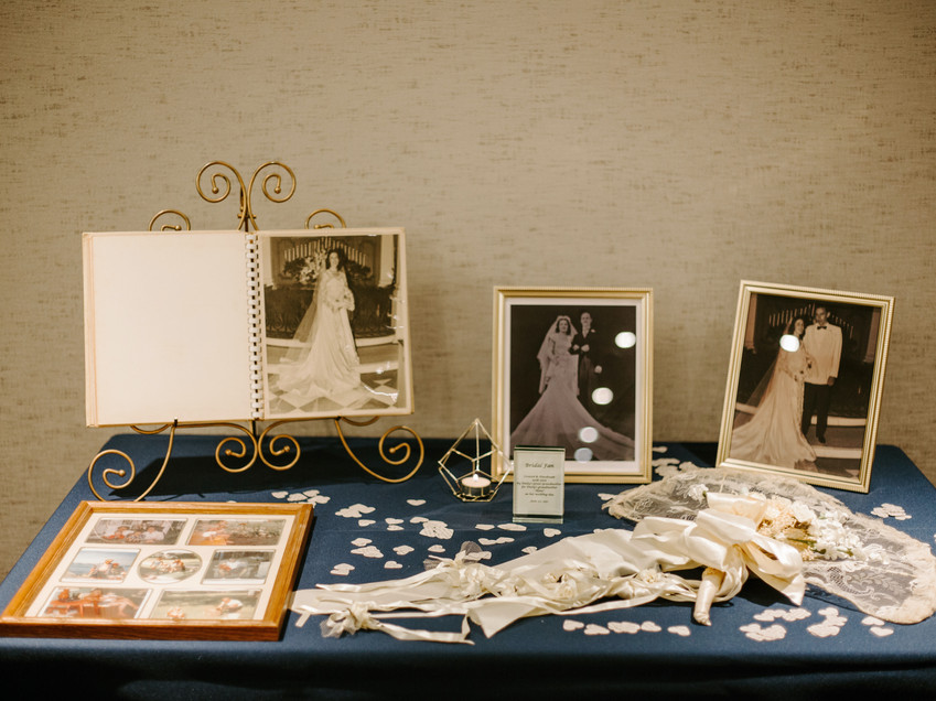 memorial table at wedding with photo album and legacy fan