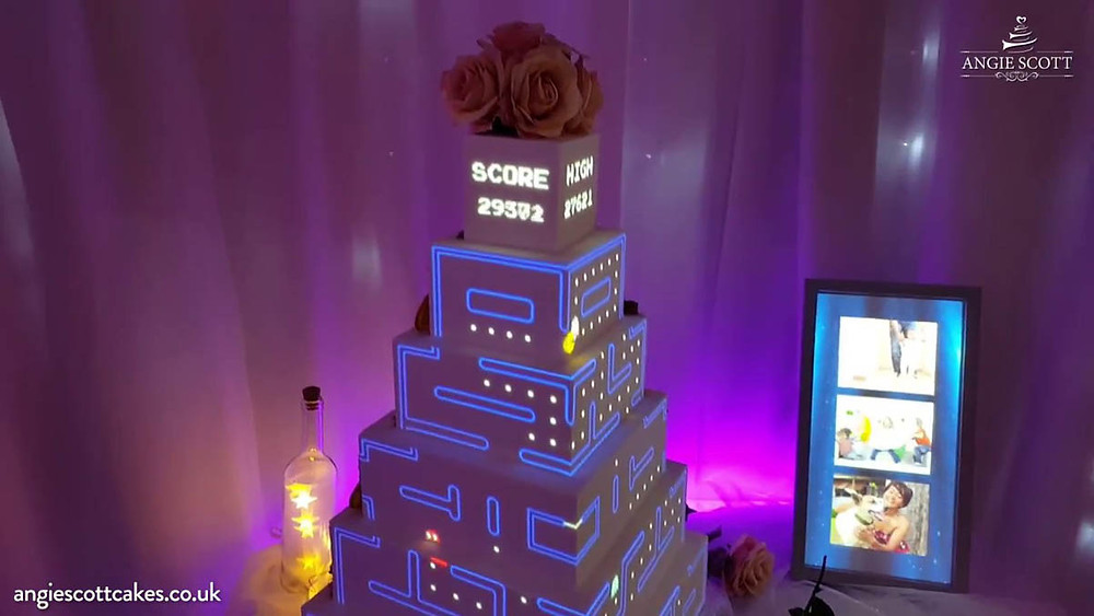 tiered wedding cake with pacman game projection mapped on sides