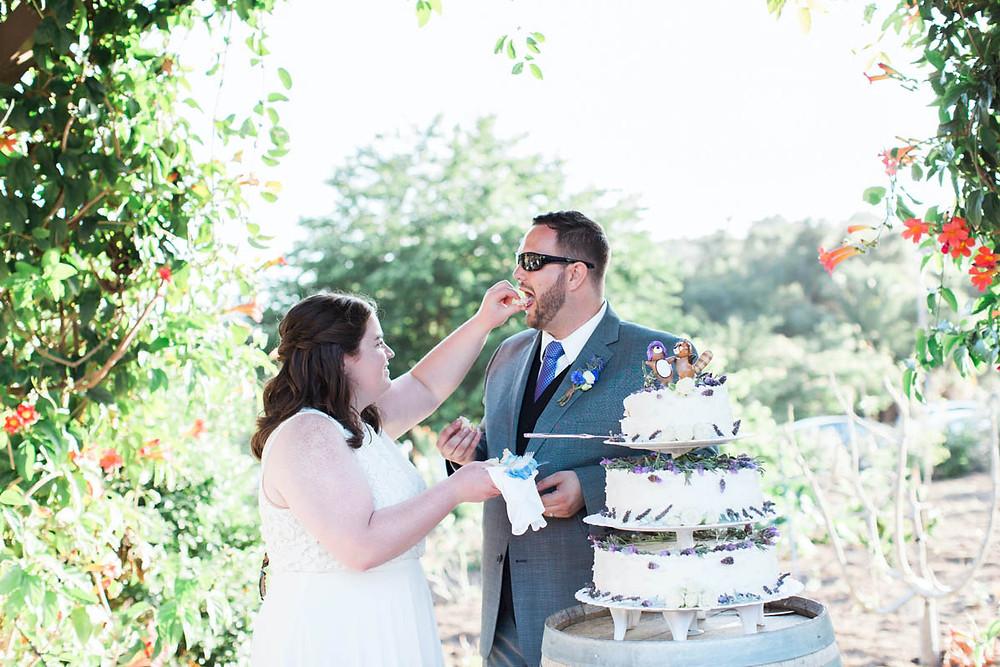 bride feeding groom a bite of cake