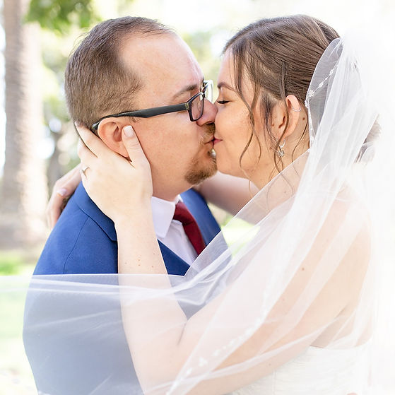 Bride and groom kissing at Rancho La Patera and Stow House in Goleta, California