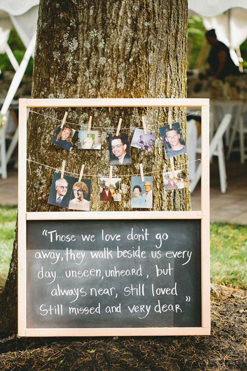 memory board at wedding with photos of departed loved ones attached with clothespins
