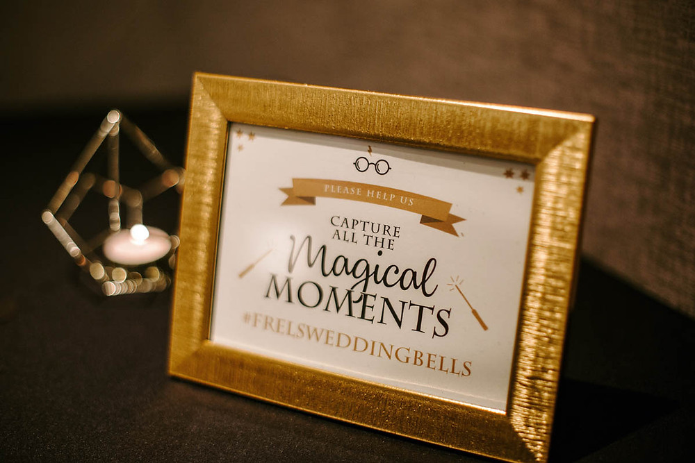 small sign displaying wedding hashtag on guestbook table