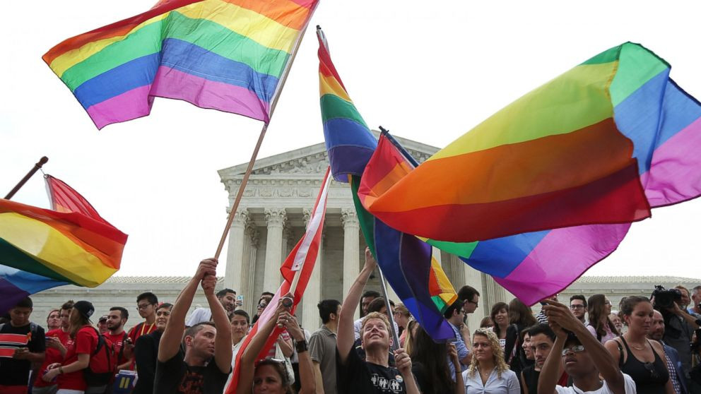 Pride flags are waved outside the United States supreme court shortly after Justice Anthony Kennedy rules same-sex marriage will be legal nationwide.