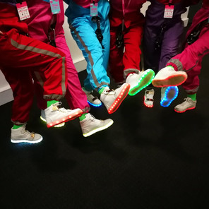 Glow shoes and jumpsuit costumes made by Emily Martineli, designed by Ala Lloyd for All or Nothing Aerial Dance, Edinburgh Hogmanay 2018