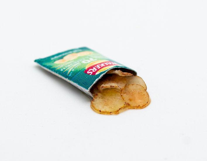 open pack of green crisp
