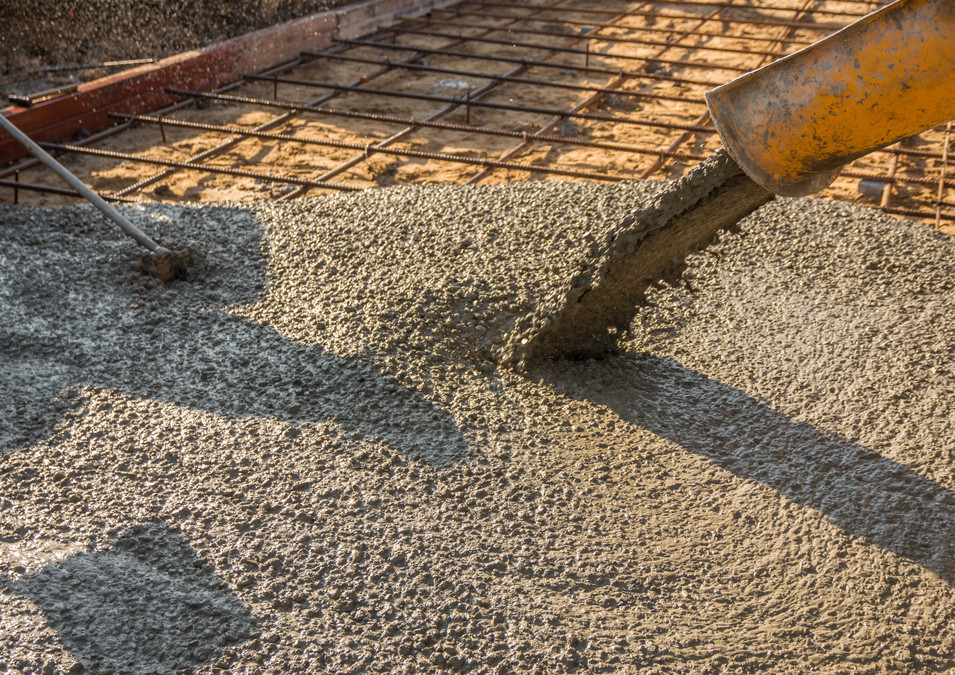 Pouring ready-mixed concrete after placi