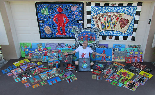 Parker Beaudoin with The Red People paintings