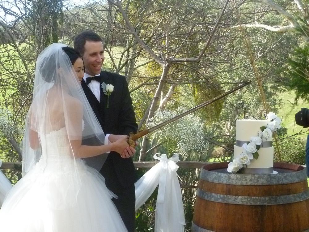 Japanese bride and Aussie groom cutting their wedding cake