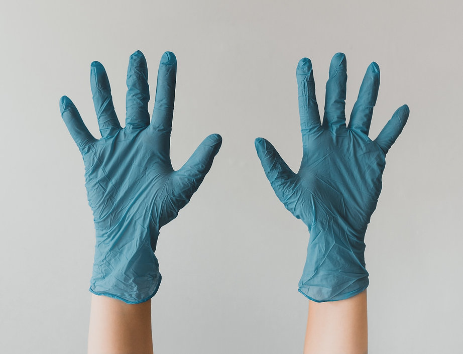 Raised hands with Cleaning Gloves