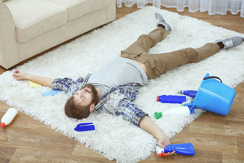 person exhausted from cleaning