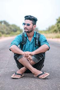 man-sitting-on-road-1315741.jpg