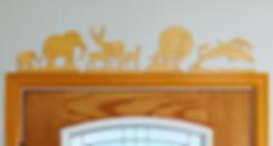 Win-Door Decor animal scenes over door.
