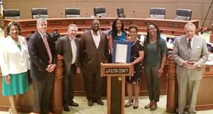 "Fulton County Commissioner Lee Morris sponsored ""Judge Gail S. Tusan Appreciation Day"" in recognition of her thirty years of judicial service. They are joined by other Commissioners, the County Attorney, and Judge Tusan's daughter, Lauren Washington"
