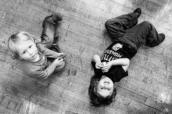 Two children pay on the floor of the Philhamonic Hall, Liverpool. Photo by Wesley Storey