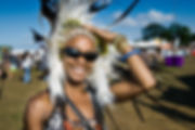 Woman i Native American head dress Shambala Festival by Wesley Storey photographer