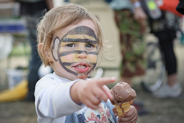 Child with ice cream, Shambala Festival
