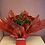 Thumbnail: Dozen Red Roses Foliage Hand-Tied in a Box