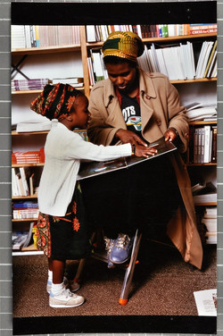 33 Mother _ Child in the Bookshop. c1980s. Huntley Archives at London Metropolitan Archives