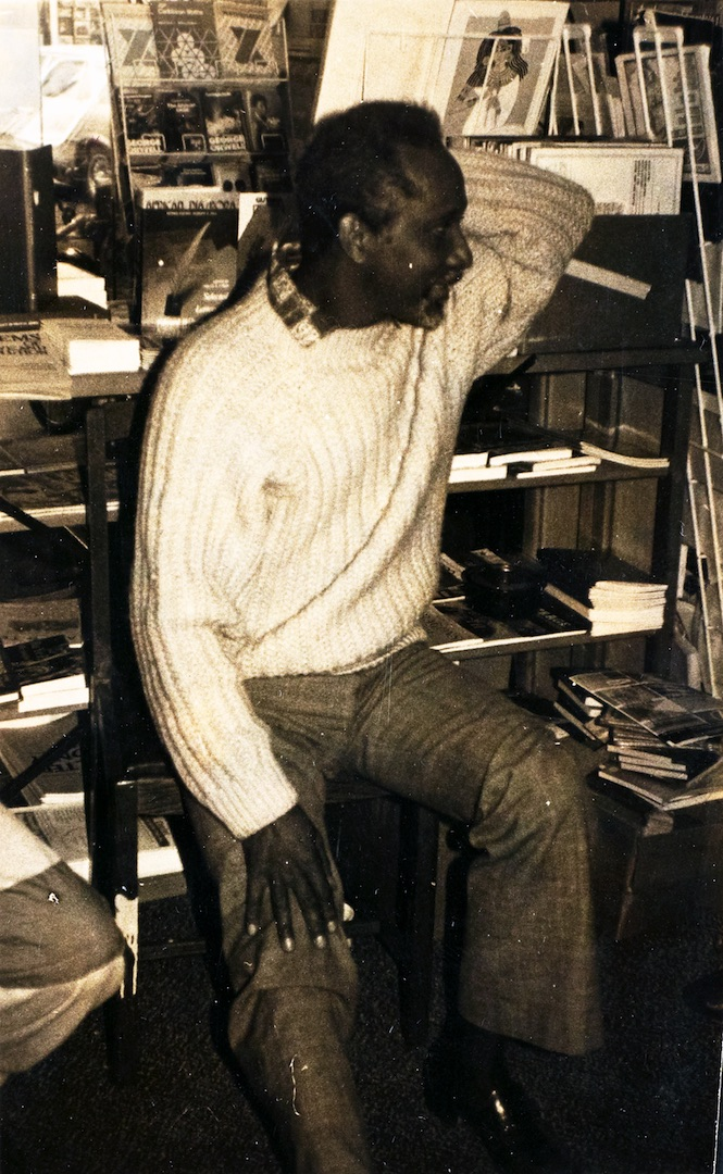 26 Eric Huntley (sitting) in the Bookshop. c1980s. Huntley Archives at London Metropolitan Archives_