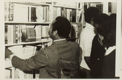20 Eric Huntley (looking through bookshevles). Huntley Archives at London Metropolitan Archives_Arch
