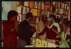 13 L to R - Ann Duncan, Eric Huntley, Imruh Bakari _ Valerie Bloom (being applauded). Huntley Archiv