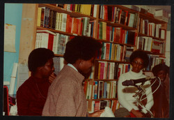 22 L to R - Ann Duncan _ Accabre Huntley (reading). Huntley Archives at London Metropolitan Archives