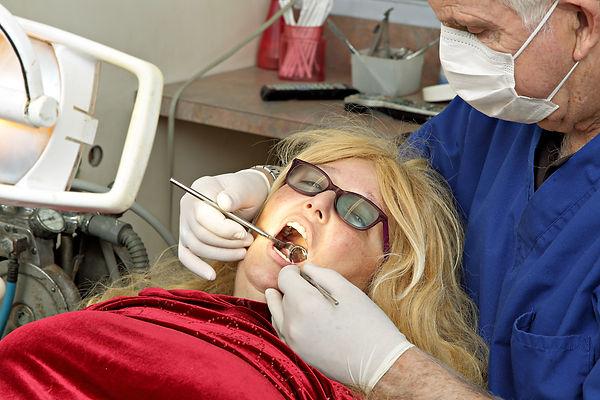 DentistWorkingOnPatient.jpg