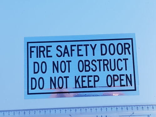 Fire door signage. Brushed silver