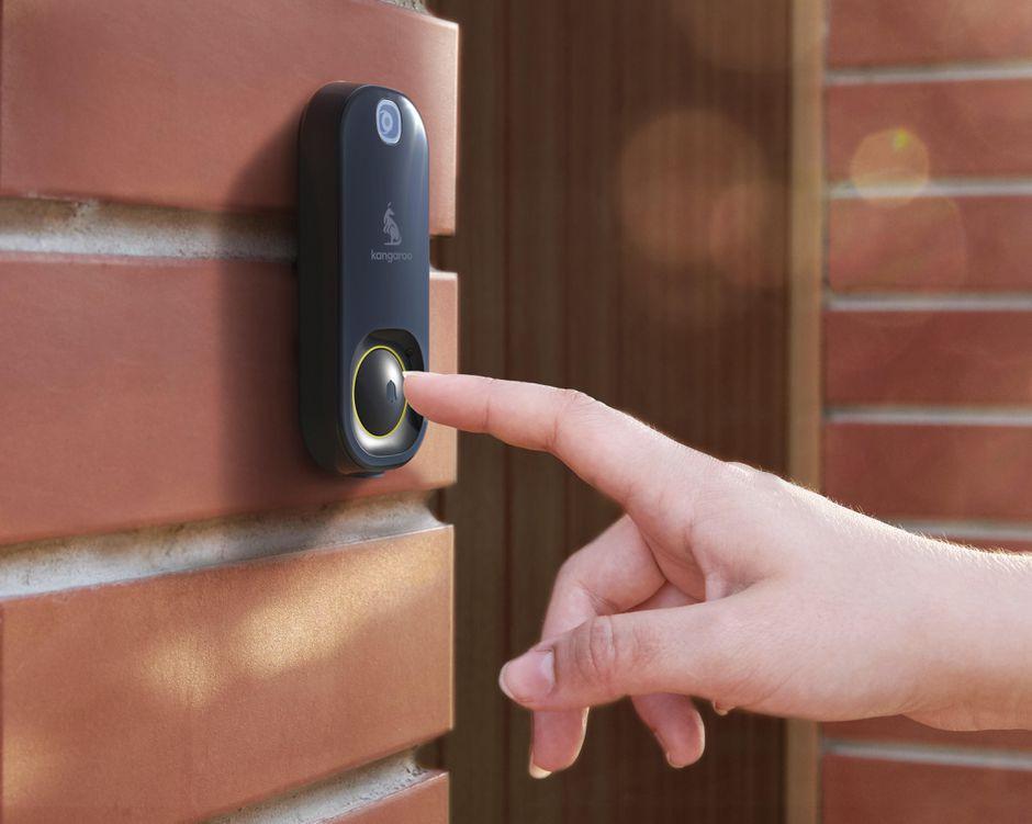 Woman using wireless doorbell