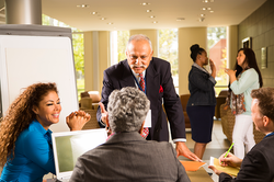 Indian-descent,-male-manager-conducts-business-presentation.-496562129_5760x3840