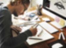 Designer at WIX Builders working on a logo sketch