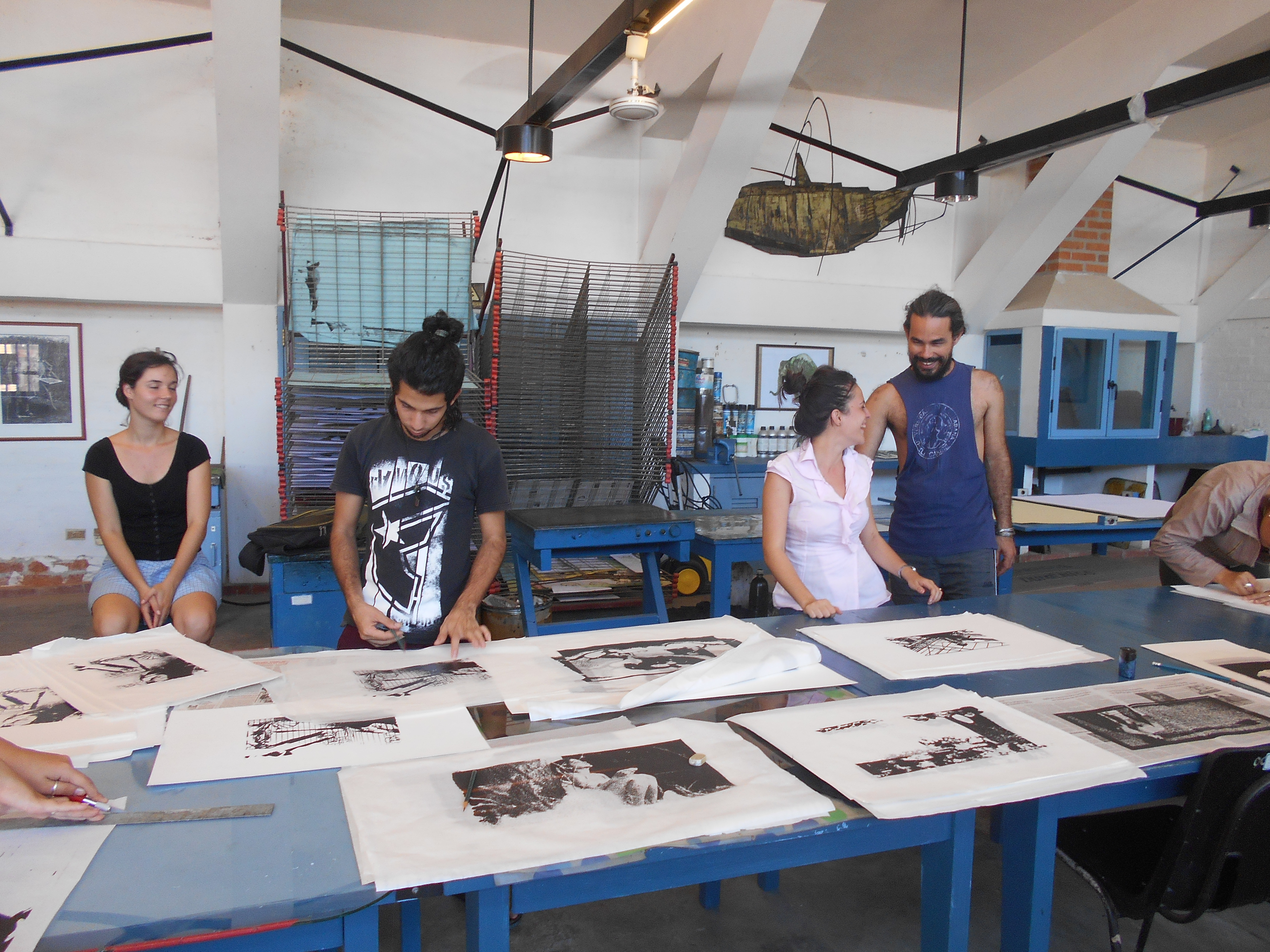 Students with finished artworks