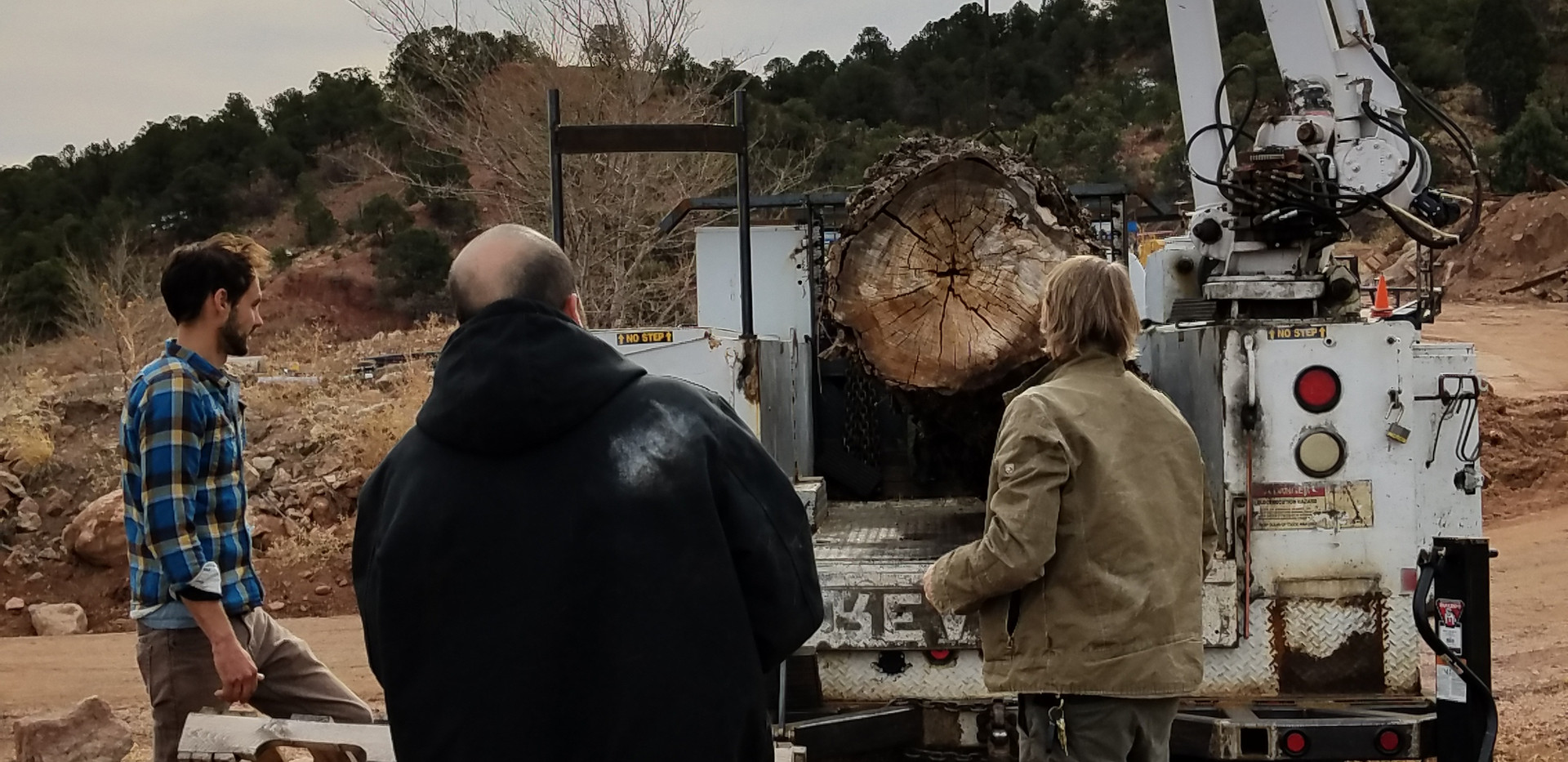 The team moving the stump to be carved.
