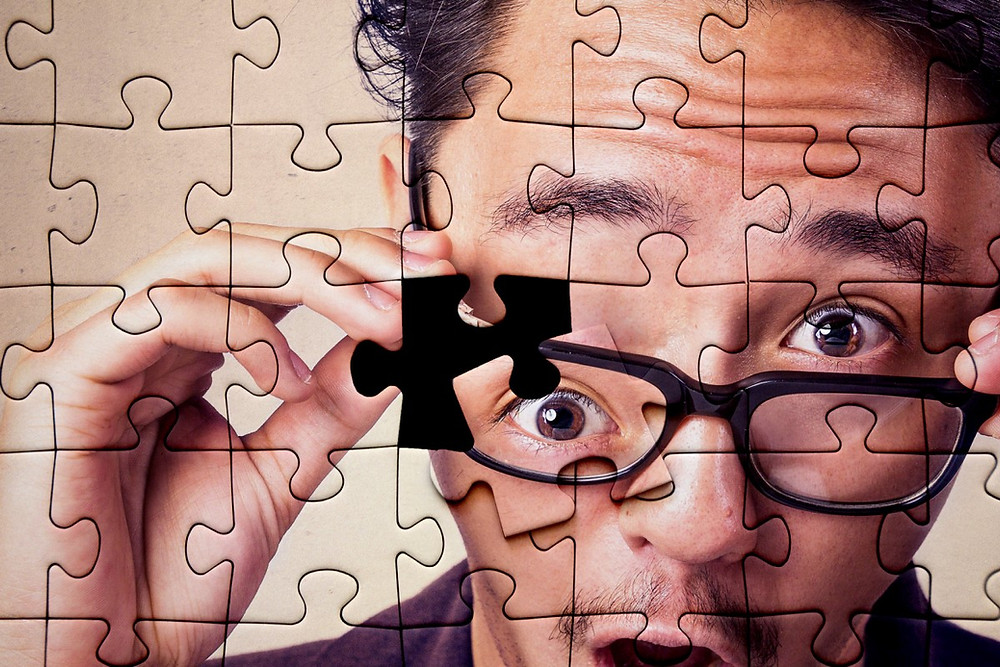 Puzzle of man in glasses