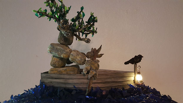 Living tree in a handmade row boat