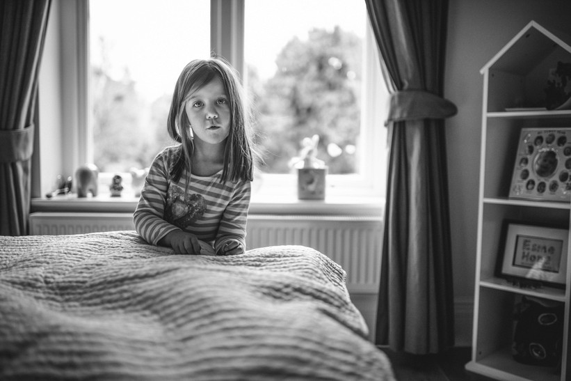 Black and white picture of girl at home