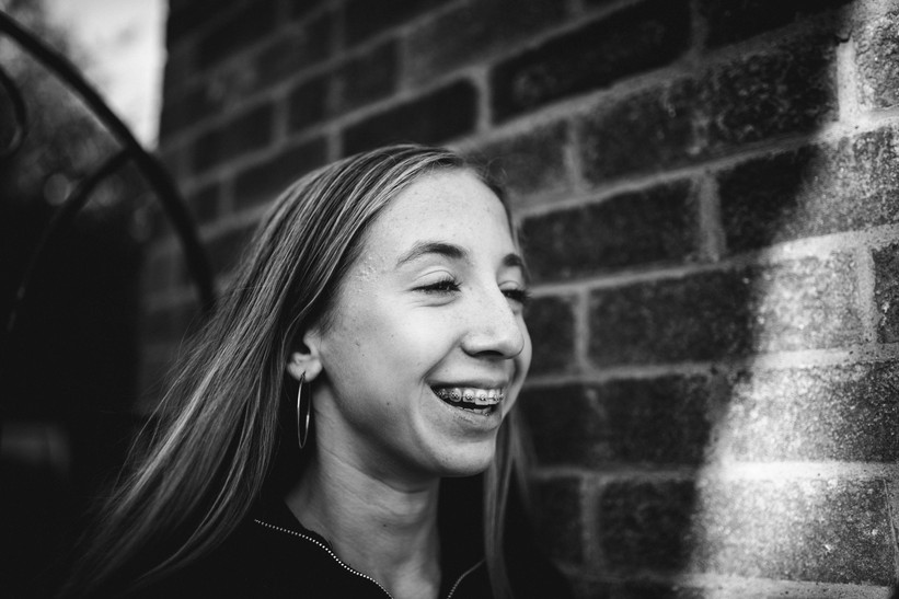 Black and white portrait of girl outside