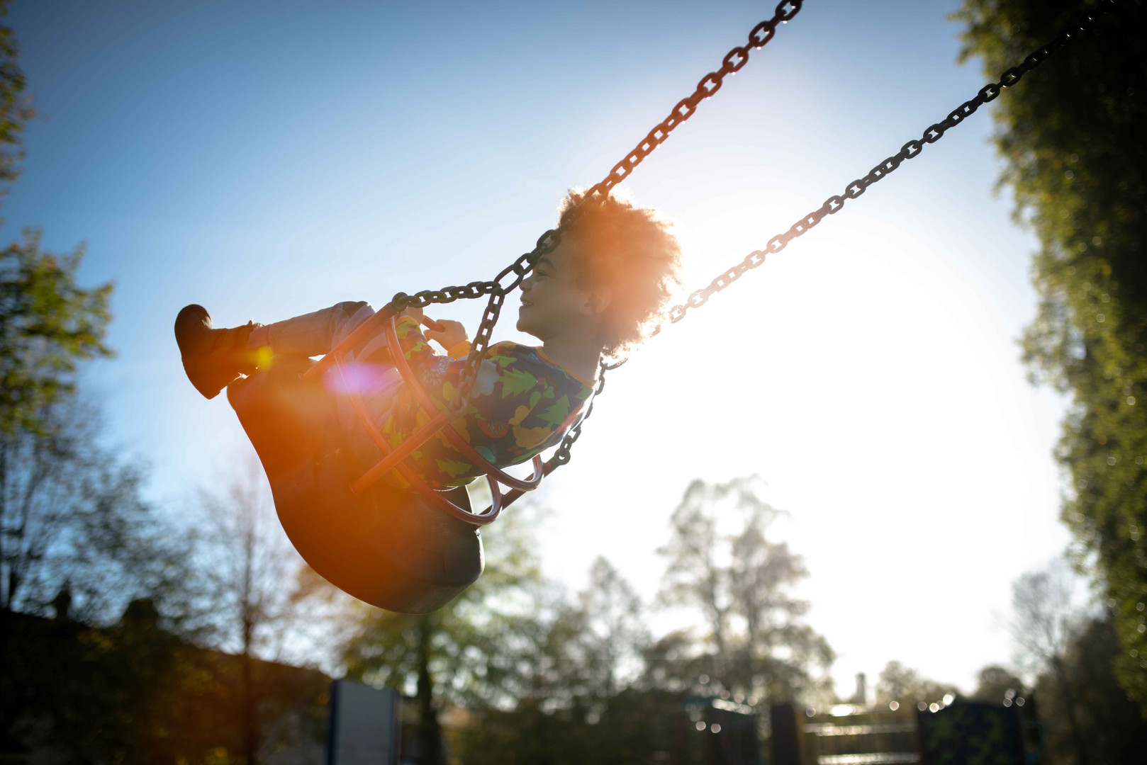 Child on a swing in the park
