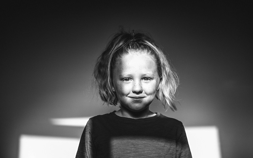 Black and white portrait of a girl in shadow