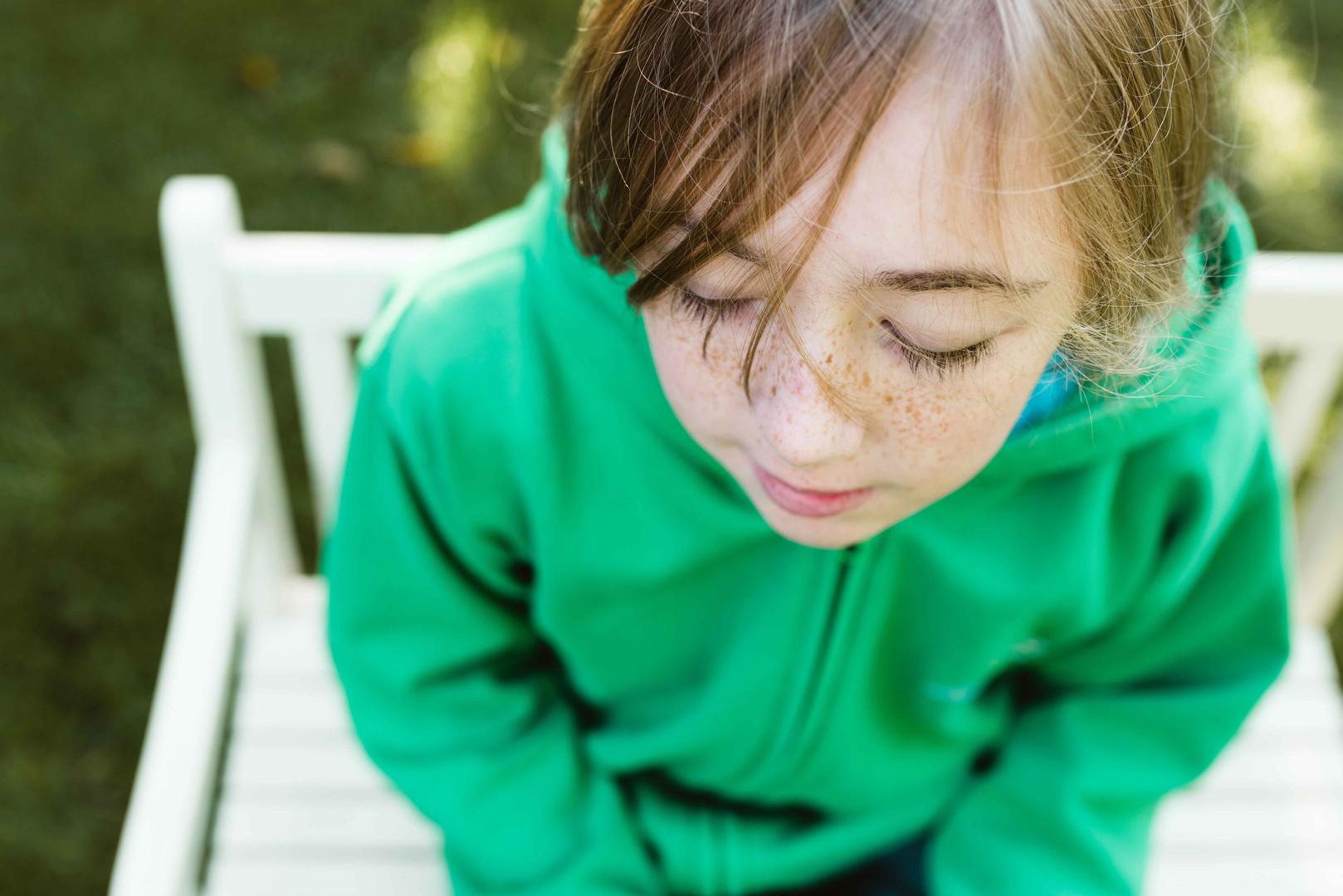 Girl sitting in the garden