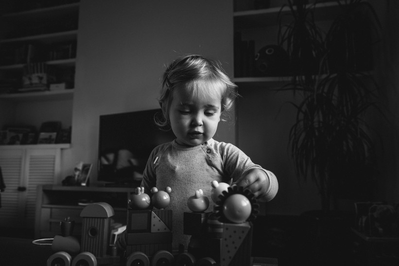 Black and white picture of girl playing with toys