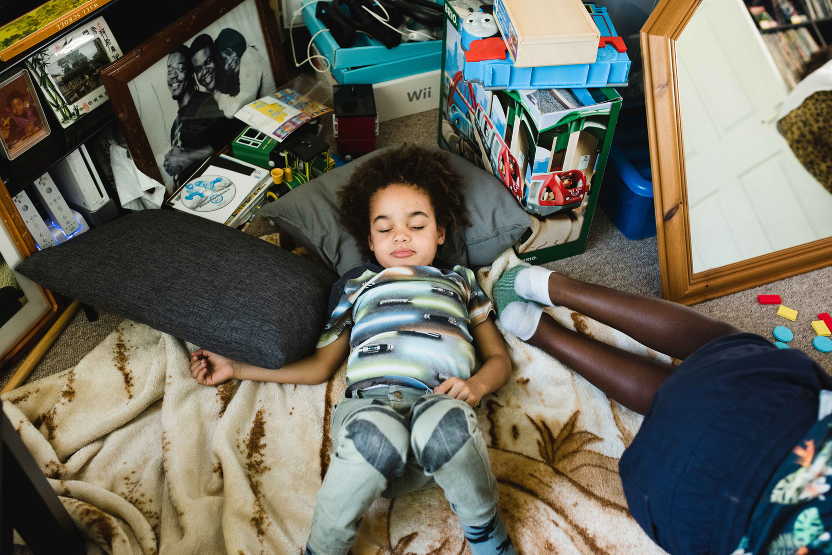 Family documentary picture showing young child relaxing indoors