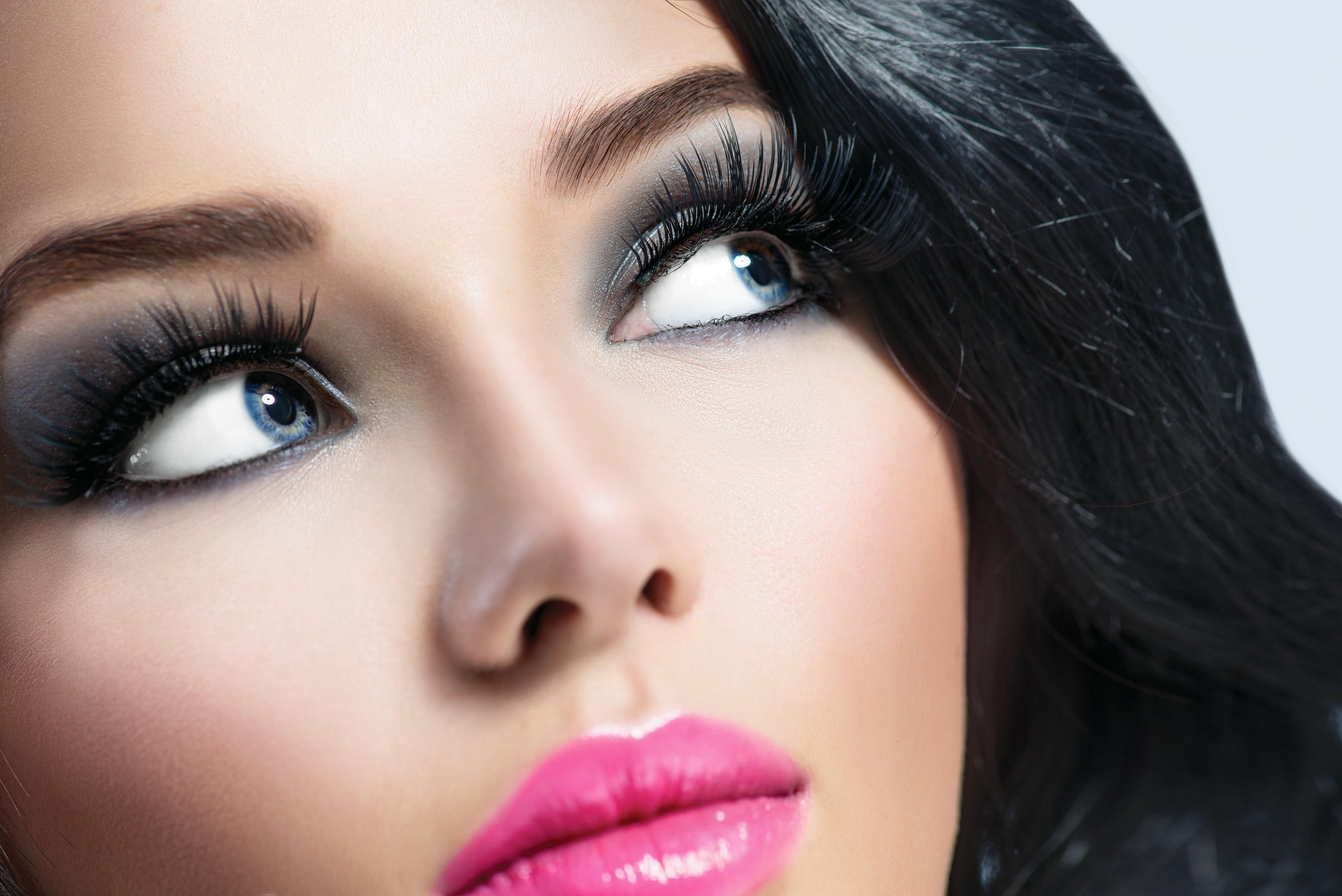 Beautiful Brunette Girl with Healthy Black Hair and perfect make up,perfect skin. Smoky eyes,long ey