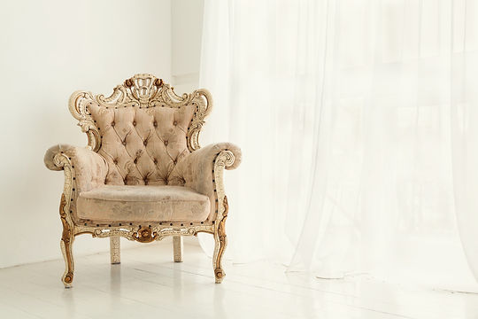 Vintage armchair against white wall and